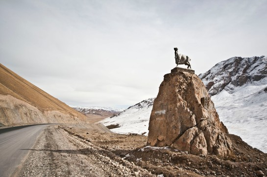A statue of a headless goat stands atop a boulder along the Southern Corridor highway that leads to the Irkeshtam Border Pass with China. The headless goat carcass is used in a game of polo in Central Asia, called buzkashi.
